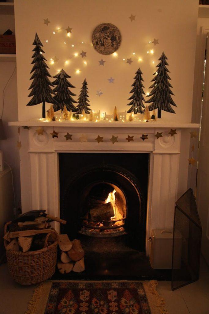 Décorer sa cheminée à Noël la lumière